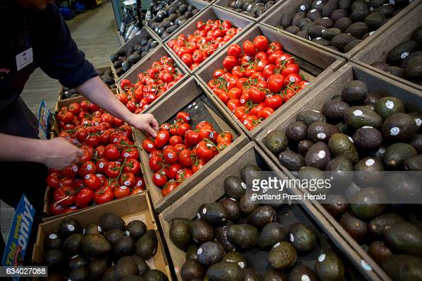 Will Mac a produce associate at Hannaford in Falmouth stocks tomatoes and avocados in the front of the store so that shoppers can easily grab them...