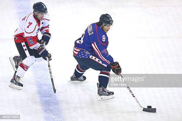 Will MacDonald of the USA controls the puck against Liam Heelis of Canada during the International Ice Hockey Series match between the USA and Canada...