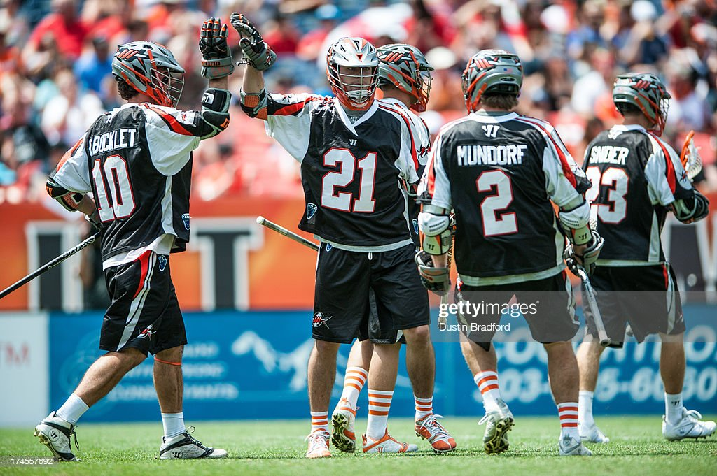 Will Mangan #21 of the Denver Outlaws celebrates a second half goal against the Chesapeake Bayhawks during a Major League Lacrosse game at Sports Authority Field at Mile High on July 27, 2013 in Denver, Colorado. The Outlaws beat the Bayhawks 14-12.