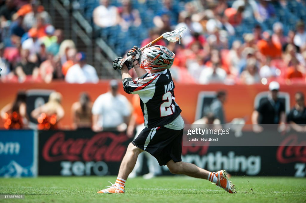 Will Mangan #21 of the Denver Outlaws shoots and scores a second half goal against the Chesapeake Bayhawks during a Major League Lacrosse game at Sports Authority Field at Mile High on July 27, 2013 in Denver, Colorado. The Outlaws beat the Bayhawks 14-12.