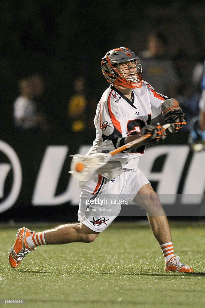 Will Mangan #21 of the Denver Outlaws shoots on the goal in the second half against the Ohio Machine on May 4, 2013 at Selby Stadium in Delaware, Ohio. Denver defeated Ohio 13-8.