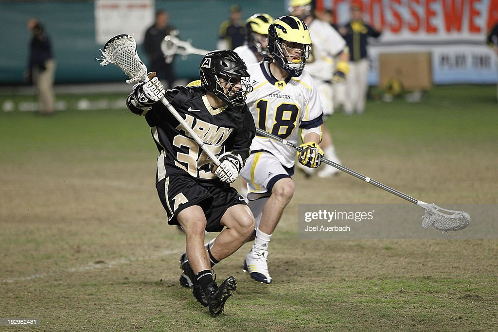 Will Mazzone #35 of the Army Black Knights defends against Paxton Moore #18 of the Michigan Wolverines as he runs up field with the ball during the 2013 Orange Bowl Lacrosse Classic on March 2, 2013 at SunLife Stadium in Miami Gardens, Florida. Army defeated Michigan 12-1.