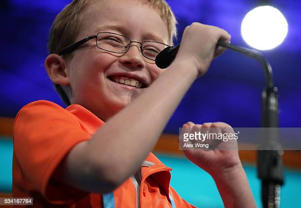 Will McCollom of Tulsa Oklahoma celebrates after he correctly spelled his word in round two of the 2016 Scripps National Spelling Bee May 25 2016 in...