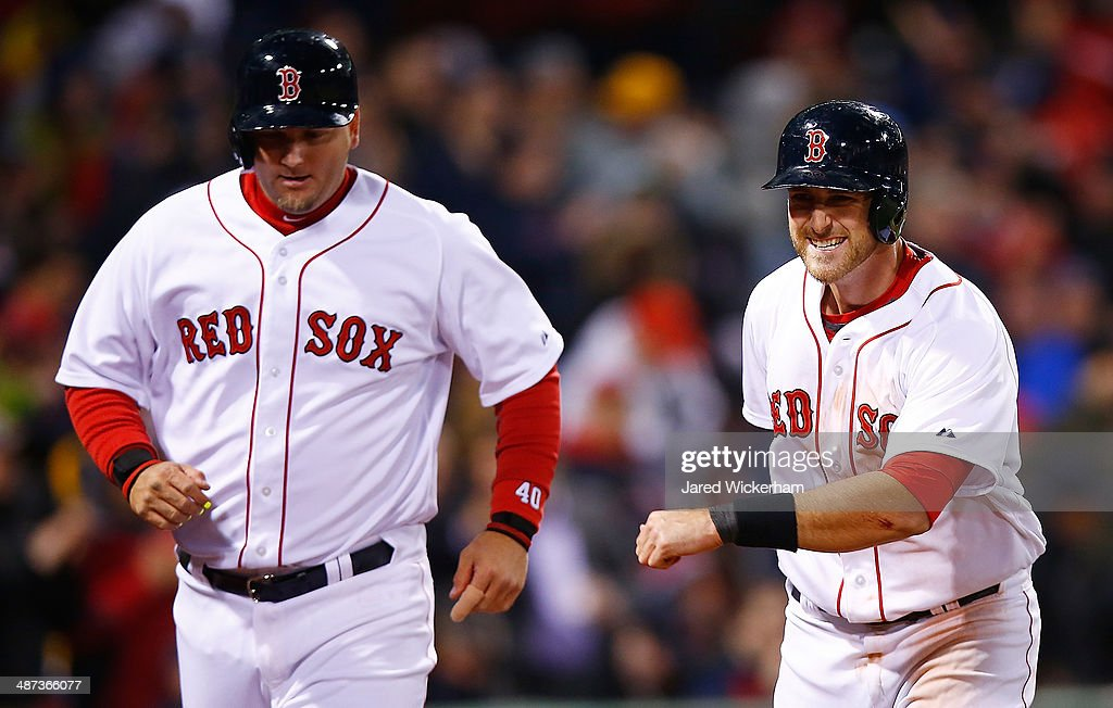 Will Middlebrooks #16 and A.J. Pierzynski #40 of the Boston Red Sox celebrate after scoring in the sixth inning off of a Jackie Bradley, Jr. #25 double against the Tampa Bay Rays during the game at Fenway Park on April 29, 2014 in Boston, Massachusetts.