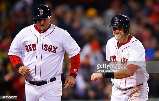 Will Middlebrooks and AJ Pierzynski of the Boston Red Sox celebrate after scoring in the sixth inning off of a Jackie Bradley Jr #25 double against...