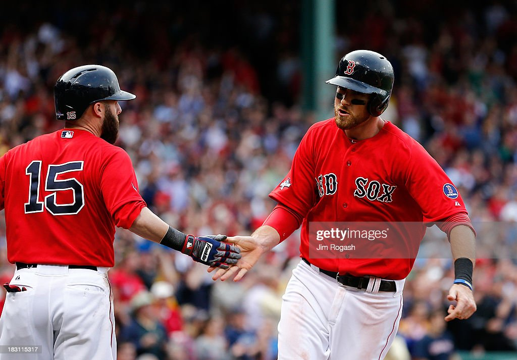 Will Middlebrooks #16 celebrates a run with Dustin Pedroia #15 of the Boston Red Sox against the Tampa Bay Rays during Game One of the American League Division Series at Fenway Park on October 4, 2013 in Boston, Massachusetts.