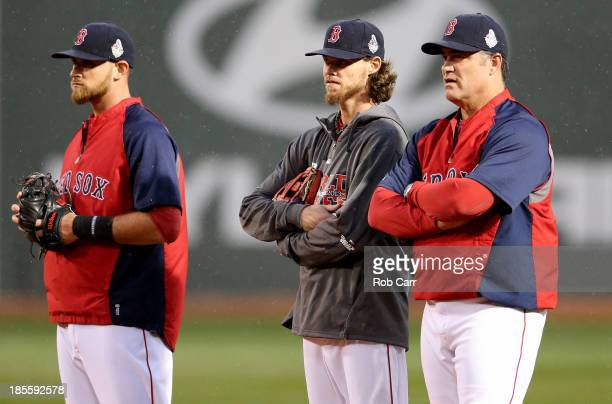 Will Middlebrooks Clay Buchholz and manager John Farrell of the Boston Red Sox talk during team workout in the 2013 World Series Media Day at Fenway...