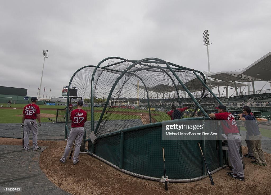 Will Middlebrooks #16, Mike Carp #37 and A.J. Pierzynski #40 of the Boston Red Sox watch as David Ortiz #34 takes batting practice during a Spring Training workout at jetBlue Park on February 25, 2014 in Fort Myers, Florida.