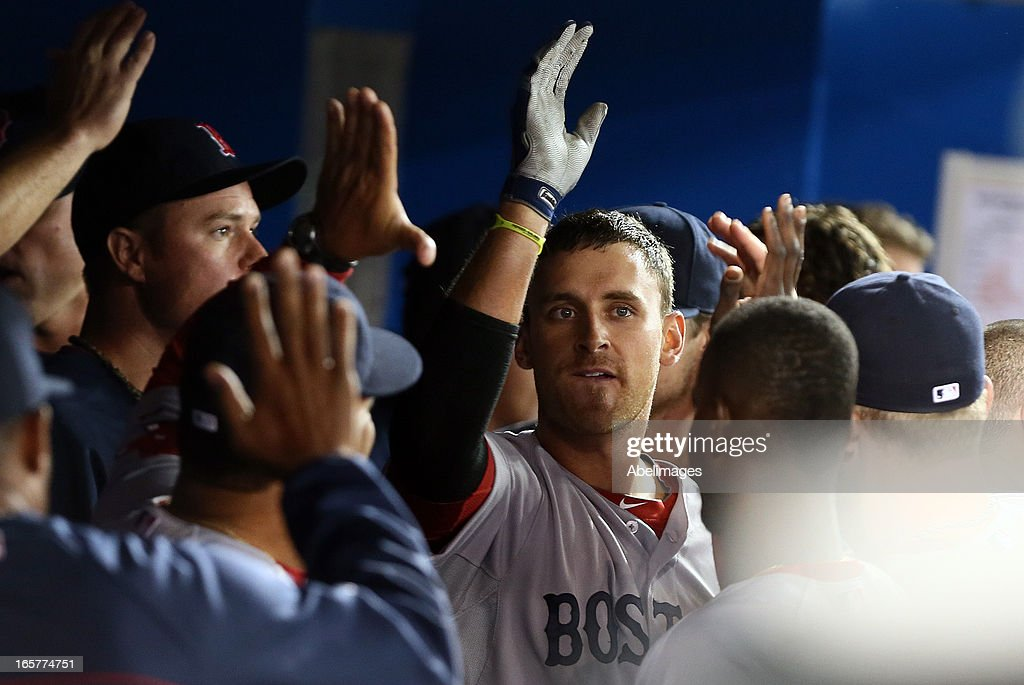 Will Middlebrooks #16 of the Boston Red Sox celebrates his solo home run in the 9th inning against the Toronto Blue Jays during MLB action at the Rogers Centre April 5, 2013 in Toronto, Ontario, Canada.