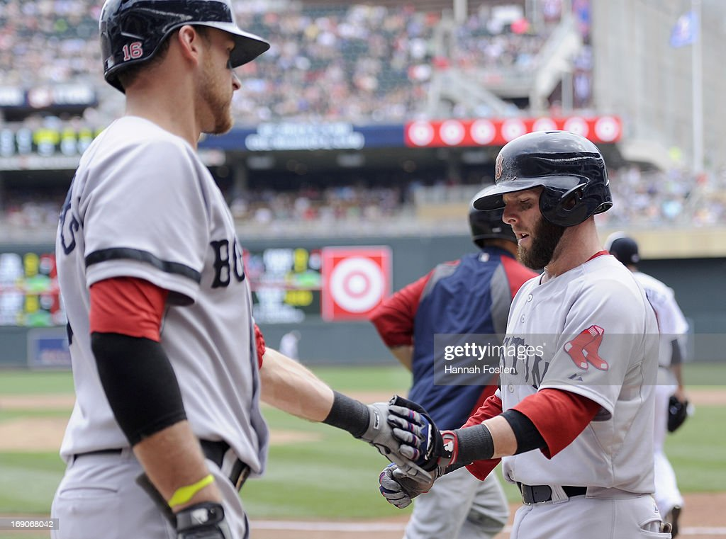 <a gi-track='captionPersonalityLinkClicked' href=/galleries/search?phrase=Will+Middlebrooks&family=editorial&specificpeople=7934204 ng-click='$event.stopPropagation()'>Will Middlebrooks</a> #16 of the Boston Red Sox congratulates teammate <a gi-track='captionPersonalityLinkClicked' href=/galleries/search?phrase=Dustin+Pedroia&family=editorial&specificpeople=836339 ng-click='$event.stopPropagation()'>Dustin Pedroia</a> #15 on scoring a run against the Minnesota Twins during the fifth inning of the game on May 19, 2013 at Target Field in Minneapolis, Minnesota.