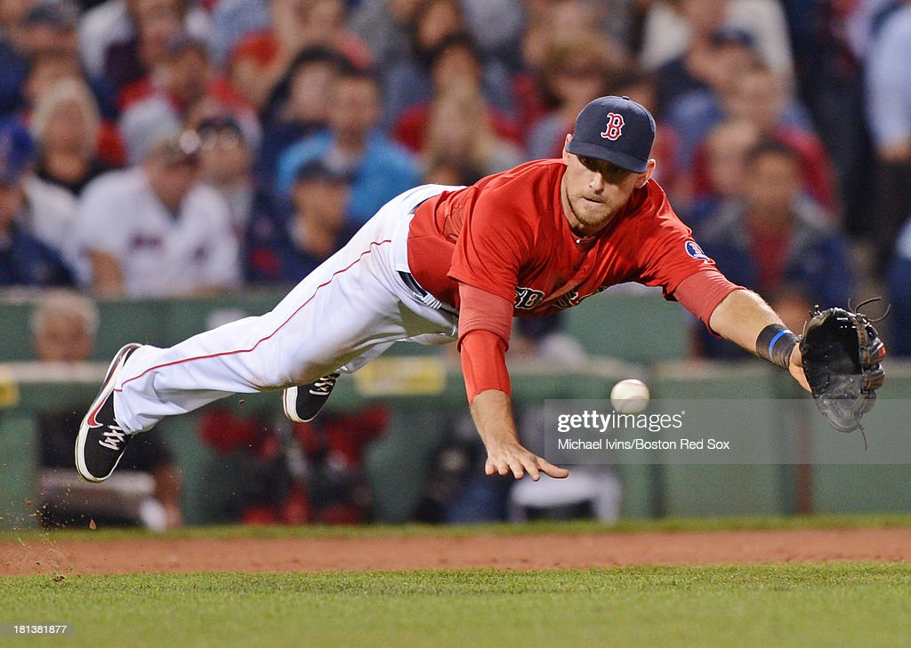 Will Middlebrooks #16 of the Boston Red Sox dives for a ground ball against the Toronto Blue Jays in the fifth inning on September 20, 2013 at Fenway Park in Boston, Massachusetts. Middlebooks finished the play to record the put out.