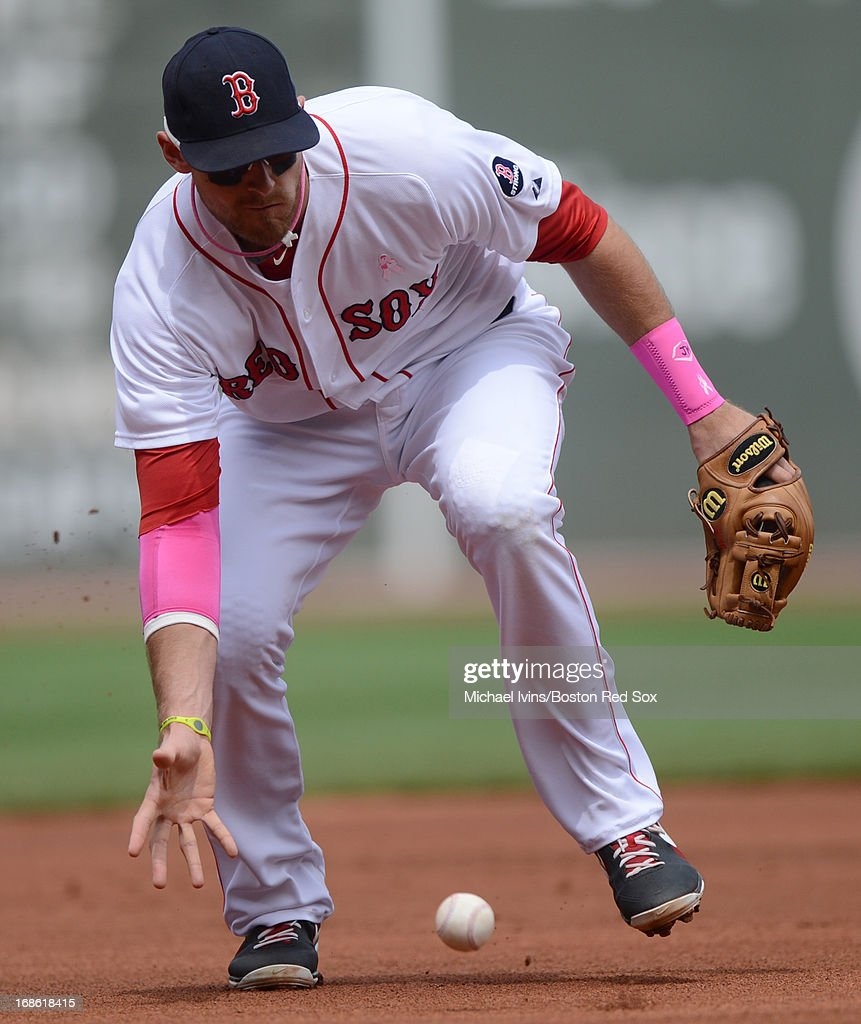 WIll Middlebrooks #16 of the Boston Red Sox fields a ball with his bare hand against the Toronto Blue Jays in the first inning on May 12, 2013 at Fenway Park in Boston, Massachusetts.