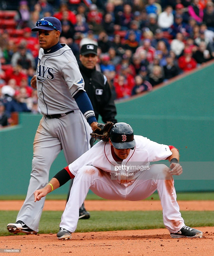 <a gi-track='captionPersonalityLinkClicked' href=/galleries/search?phrase=Will+Middlebrooks&family=editorial&specificpeople=7934204 ng-click='$event.stopPropagation()'>Will Middlebrooks</a> #16 of the Boston Red Sox is caught out in a run down by Yunel Escobar #11 of the Tampa Bay Rays in the sixth inning at Fenway Park on April 14, 2013 in Boston, Massachusetts.