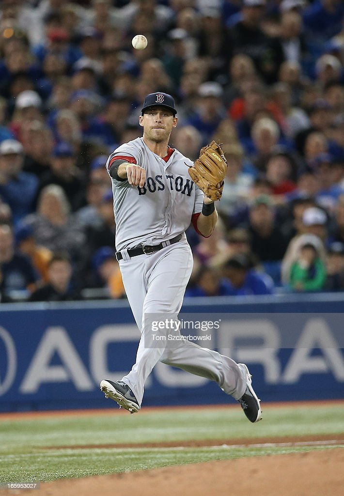 Will Middlebrooks #16 of the Boston Red Sox throws out the baserunner in the fourth inning during MLB game action against the Toronto Blue Jays on April 7, 2013 at Rogers Centre in Toronto, Ontario, Canada.