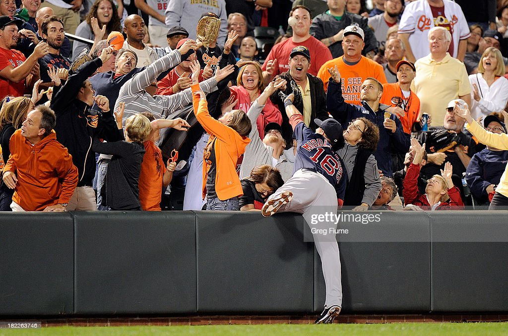 <a gi-track='captionPersonalityLinkClicked' href=/galleries/search?phrase=Will+Middlebrooks&family=editorial&specificpeople=7934204 ng-click='$event.stopPropagation()'>Will Middlebrooks</a> #16 of the Boston Red Sox tries to catch a foul ball in the sixth inning against the Baltimore Orioles at Oriole Park at Camden Yards on September 28, 2013 in Baltimore, Maryland.