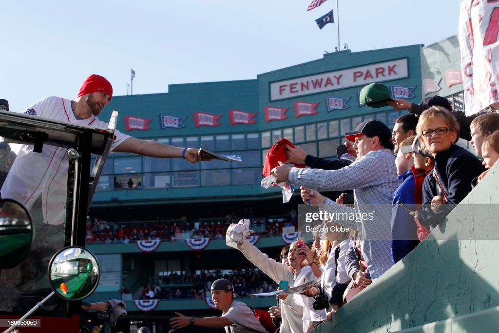 Will Middlebrooks signed autographs at Fenway Park before the start of the Rolling Rally duck boat parade to celebrate the Boston Red Sox's World Series victory on Saturday, Nov. 2, 2013.