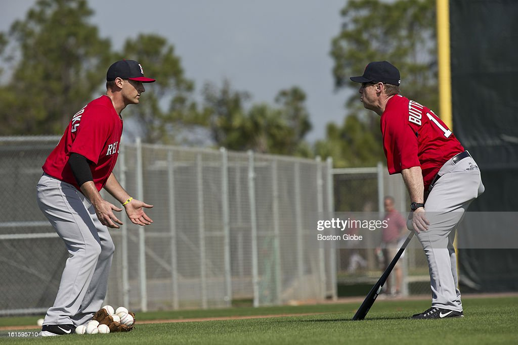 Will Middlebrooks working with third base coach Brian Butterfield during the first official spring training day for the Boston Red Sox pitchers and catchers at JetBlue Park on Tuesday, Feb. 12, 2013.