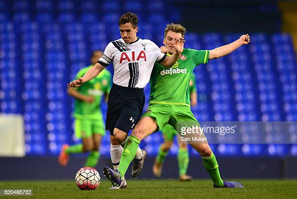 Will Miller of Tottenham Hotspur holds off Martin Smith of Sunderland during the Barclays U21 Premier League match between Tottenham Hotspur U21 and...