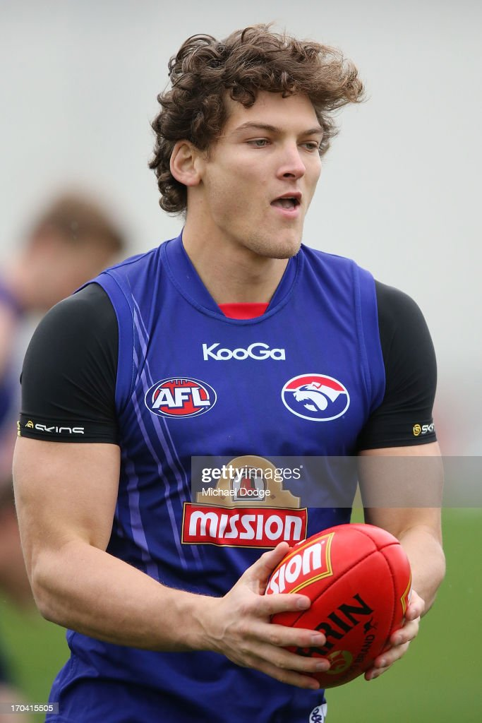 Will Minson looks ahead with the ball during a Western Bulldogs AFL training session at Whitten Oval on June 13, 2013 in Melbourne, Australia.