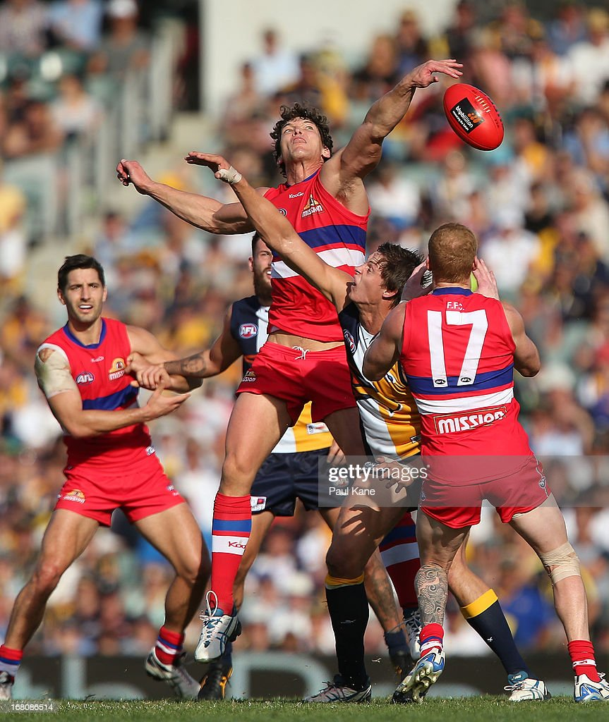 Will Minson of the Bulldogs and Callum Sinclair of the Eagles contest the ruck during the round six AFL match between the West Coast Eagles and the Western Bulldogs at Patersons Stadium on May 5, 2013 in Perth, Australia.