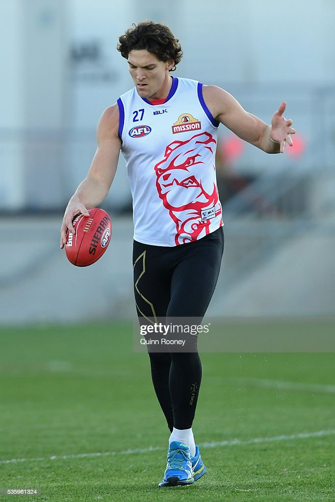 Will Minson of the Bulldogs kicks during a Western Bulldogs AFL training session at Whitten Oval on May 31, 2016 in Melbourne, Australia.