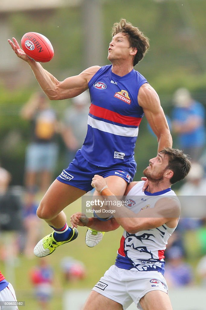 Will Minson of the Bulldogs taps the ball away against <a gi-track='captionPersonalityLinkClicked' href=/galleries/search?phrase=Tom+Campbell+-+Australian+Rules+Football+Player&family=editorial&specificpeople=12893873 ng-click='$event.stopPropagation()'>Tom Campbell</a> of the Bulldogs in a ruck contest during the Western Bulldogs AFL intra-club match at Whitten Oval on February 13, 2016 in Melbourne, Australia.