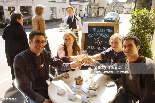 Will Moffat Ellie Wiltshire Rachell Liddington and Tom Hill share a champagne toast for the royal couple at the Blue Zucchini Brasserie in Tetbury...