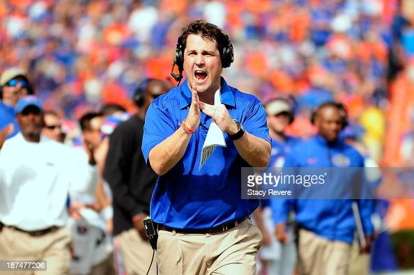 Will Muschamp head coach of the Florida Gators call for a timeout during a game against the Vanderbilt Commodores at Ben Hill Griffin Stadium on...