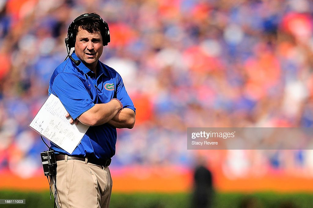 Will Muschamp head coach of the Florida Gators watches action during a game against the Vanderbilt Commodores at Ben Hill Griffin Stadium on November...