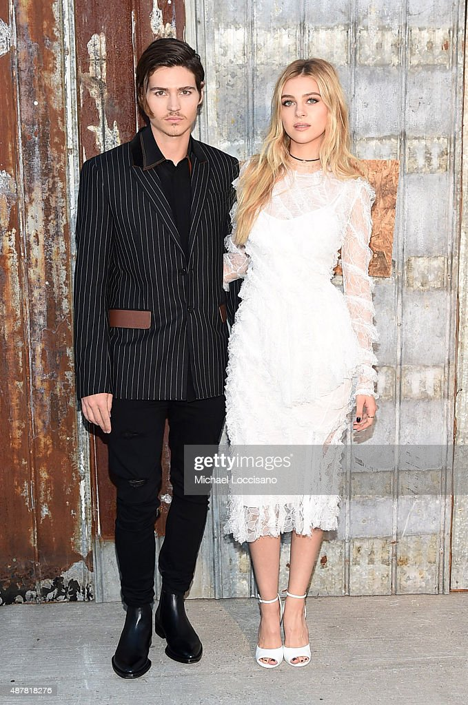 Will Peltz (L) and Nicola Peltz attend the Givenchy fashion show during Spring 2016 New York Fashion Week at Pier 26 at Hudson River Park on September 11, 2015 in New York City.