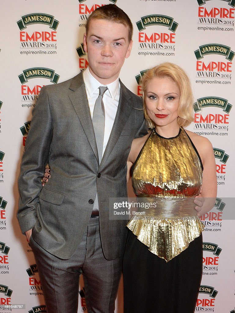 Will Poulter (L) and MyAnna Buring pose in the press room at the Jameson Empire Awards 2014 at The Grosvenor House Hotel on March 30, 2014 in London, England.
