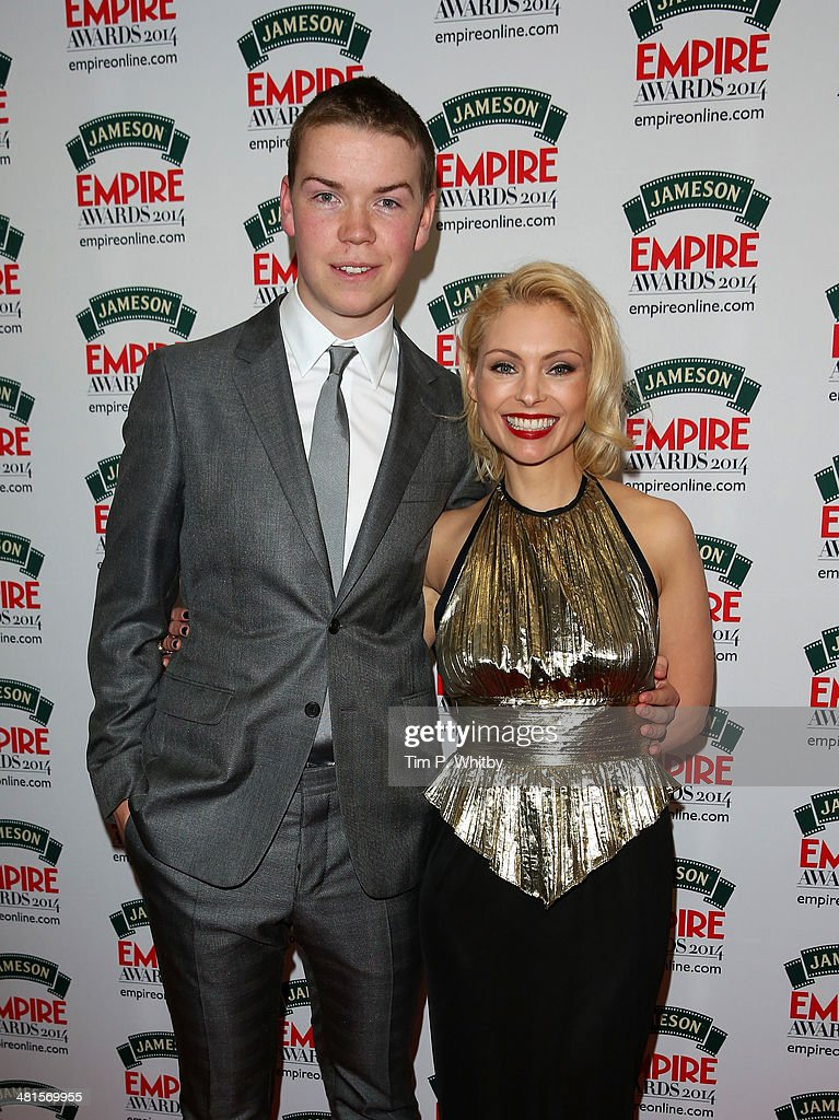 Will Poulter and MyAnna Buring pose uring the Jameson Empire Awards 2014 at the Grosvenor House Hotel on March 30, 2014 in London, England. Regarded as a relaxed end to the awards show season, the Jameson Empire Awards celebrate the film industry's success stories of the year with winners being voted for entirely by members of the public. Visit empireonline.com/awards2014 for more information.