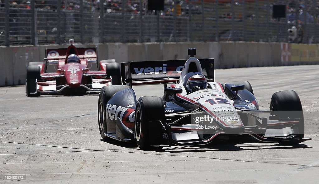 Will Power, driver of the #12 Team Penske car leads <a gi-track='captionPersonalityLinkClicked' href=/galleries/search?phrase=Scott+Dixon&family=editorial&specificpeople=183395 ng-click='$event.stopPropagation()'>Scott Dixon</a> of New Zealand, driver of the #9 Target Chip Ganassi Racing Honda Dallara, during the Shell And Pennzoil Grand Prix Of Houston Race #2 at Reliant Park on October 6, 2013 in Houston, Texas.