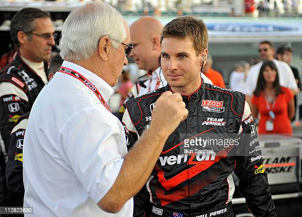 Will Power listens to instruction from car owner Roger Penske before the start of the Cafes do Brasil Indy 300 race at Homestead Miami Speedway in...