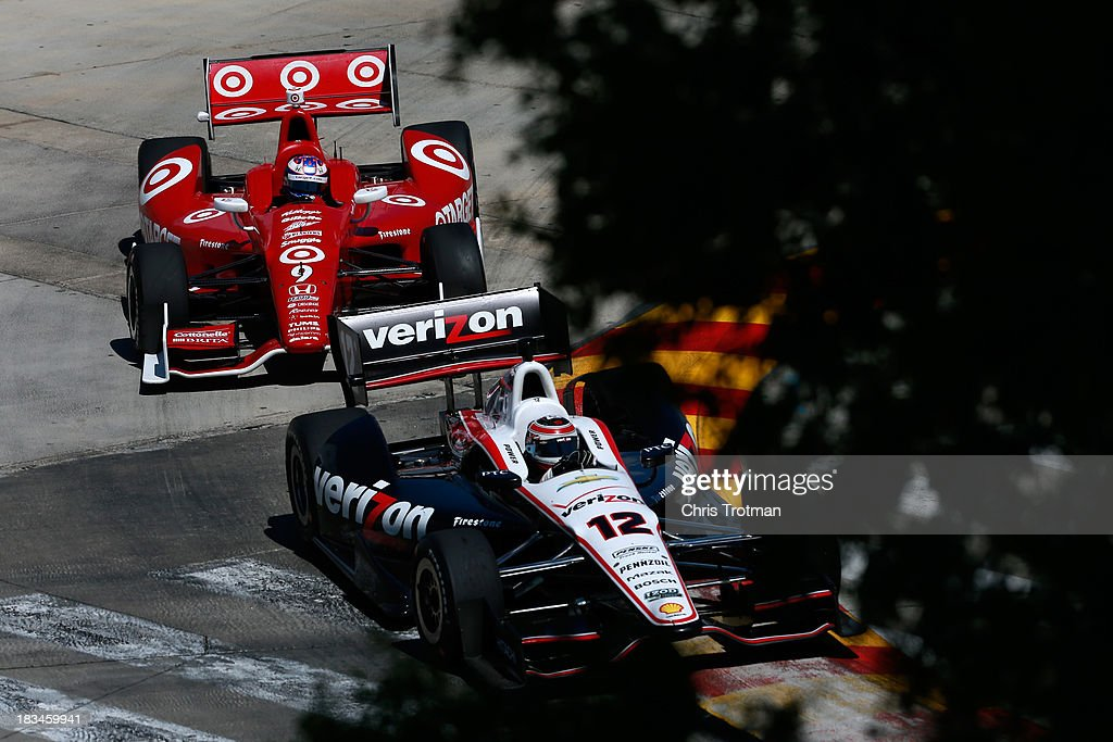 Will Power of Australia, driver of the #12 Team Penske Chevrolet Dallara leads Scott Dixon of New Zealand, driver of the #9 Target Chip Ganassi Racing Honda Dallara during the IZOD IndyCar Series Shell and Pennzoil Grand Prix Of Houston Race #2 at Reliant Park on October 6, 2013 in Houston, Texas.