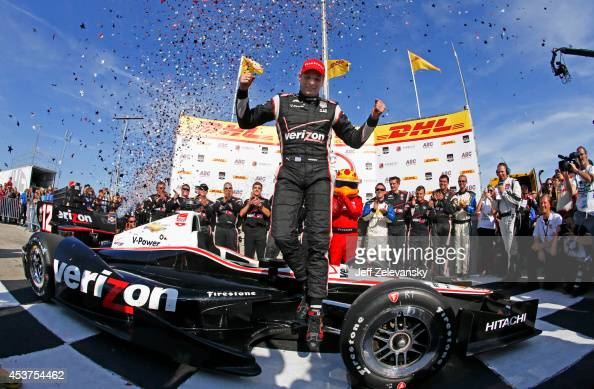 Will Power of Australia driver of the Verizon Team Penske Chevrolet celebrates in victory lane after winning the ABC Supply Wisconsin 250 at The...