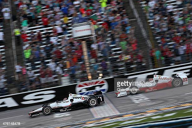 Will Power of Australia driver of the Verizon Team Penske Chevrolet leads Simon Pagenaud of France driver of the Avaya Team Penske Chevrolet at the...