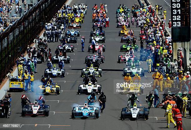 Will Power of Australia driver of the Verizon Team Penske Chevrolet Dallara James Hinchcliffe driver of the Andretti Autosport Honda Dallara and Ed...