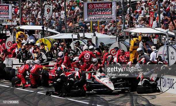 Will Power of Australia driver of the Verizon Team Penske Dallara Honda makes a pit stop during the IZOD IndyCar Series 94th running of the...