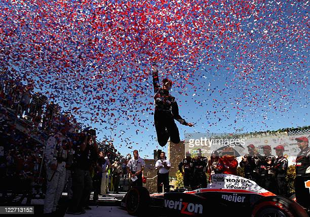 Will Power of Australia driver of the Verizon Team Penske Dallara Honda celebrates in the winners circle after he won the IZOD IndyCar Series Indy...