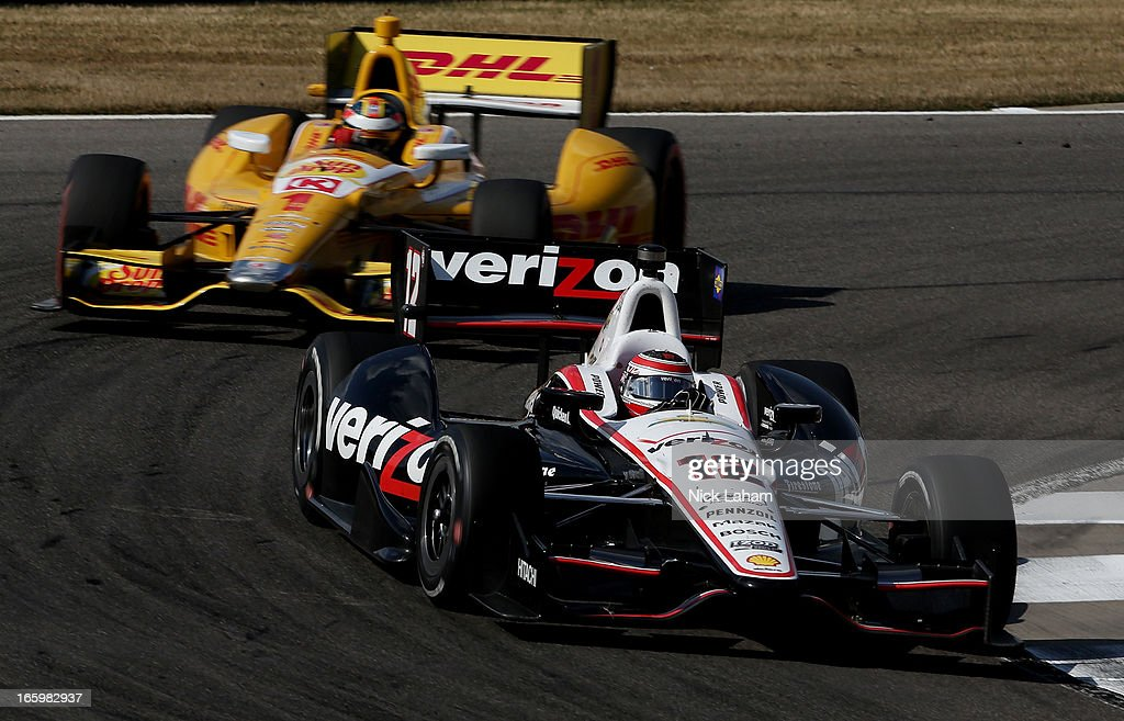 Will Power of Australia, drives the #12 Verizon Team Penske Chevrolet leads <a gi-track='captionPersonalityLinkClicked' href=/galleries/search?phrase=Ryan+Hunter-Reay&family=editorial&specificpeople=2197753 ng-click='$event.stopPropagation()'>Ryan Hunter-Reay</a>, driver of the #1 Andretti Autosport DHL Chevrolet during the Honda Indy Grand Prix of Alabama at Barber Motorsports Park on April 7, 2013 in Birmingham, Alabama.