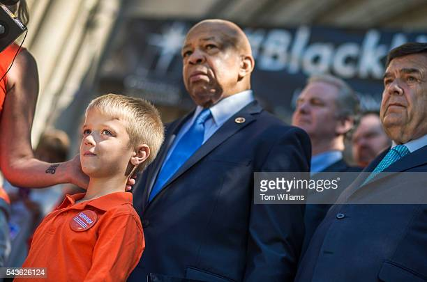 Will Ranta listens to his mother Kate Ranta a victim of gun violence speak during rally to call for action on gun safety measures on the steps of the...