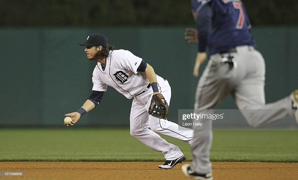 Will Rhymes of the Detroit Tigers fields the ball and makes the force out at second base of Matt LaPorta of the Cleveland Indians during the fifth...