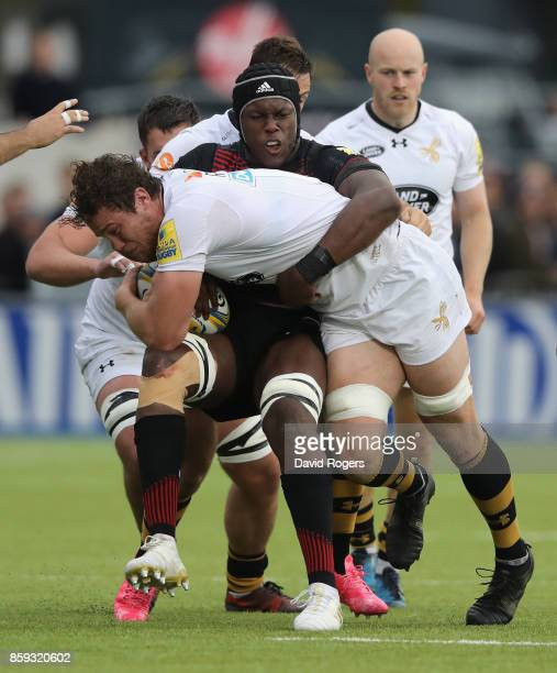 Will Rowlands of Wasps is tackled by Maro Itoje during the Aviva Premiership match between Saracens and Wasps at Allianz Park on October 8 2017 in...