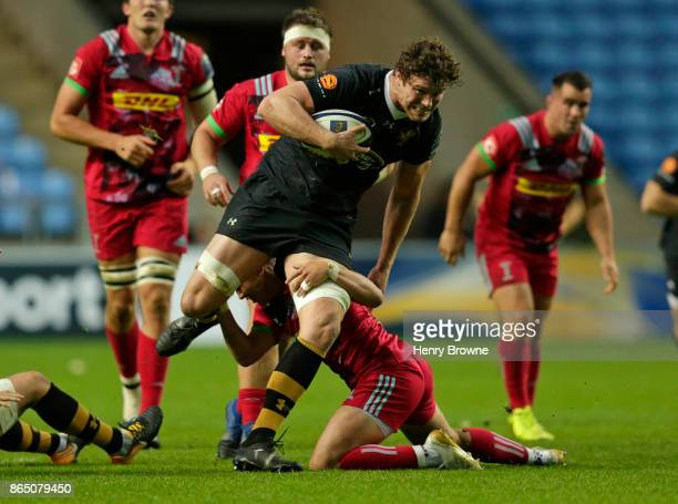 Will Rowlands of Wasps tackled by Marcus Smith of Harlequins during the European Rugby Champions Cup match between Wasps and Harlequins at Ricoh...