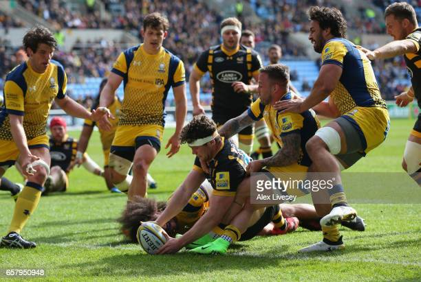 Will Rowlands of Wasps touches the ball down to score their first try during the Aviva Premiership match between Wasps v Worcester Warriors at The...
