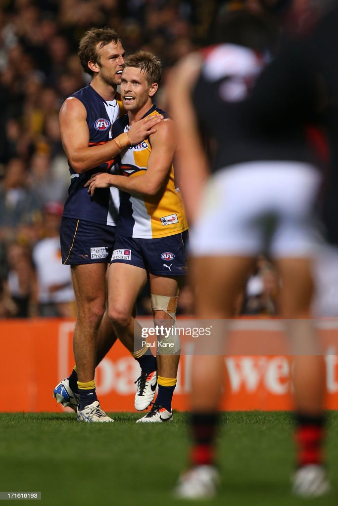 Will Schofield and <a gi-track='captionPersonalityLinkClicked' href=/galleries/search?phrase=Mark+LeCras&family=editorial&specificpeople=747453 ng-click='$event.stopPropagation()'>Mark LeCras</a> celebrate a goal during the round 14 AFL match between the West Coast Eagles and the Essendon Bombers at Patersons Stadium on June 27, 2013 in Perth, Australia.