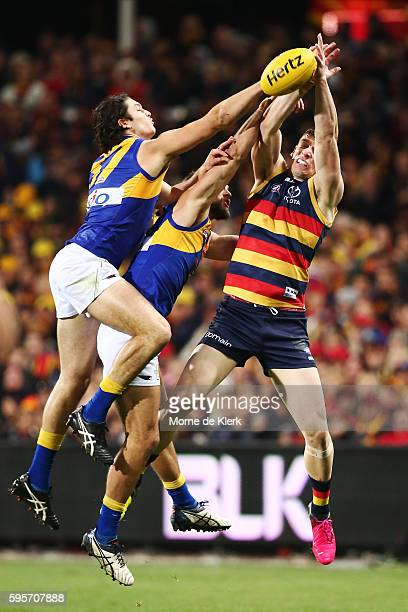 Will Schofield and Tom Barrass of the Eagles spoil a mark by Josh Jenkins of the Crows during the round 23 AFL match between the Adelaide Crows and...