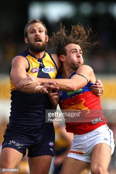 Will Schofield of the Eagles and Rhys Mathieson of the Lions contest for position during the round 19 AFL match between the West Coast Eagles and the...