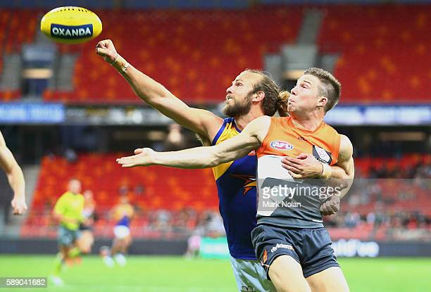 Will Schofield of the Eagles and Toby Greene of the Giants contest possession during the round 21 AFL match between the Greater Western Sydney Giants...